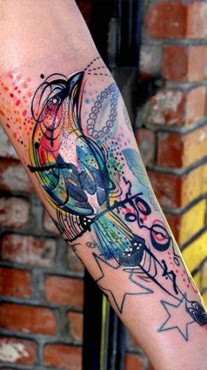 Татуировка Птица На Плече В акварельном стиле.