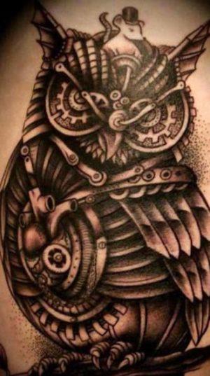 Крутая сова выполненная в тату стиле стимпанк или или паропа́нк.